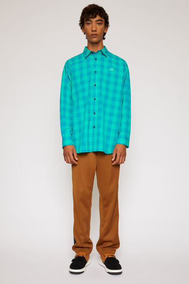 Acne Studios emerald green shirt is cut to a boxy shape with an oversized fit and patterned with a vichy-check design.