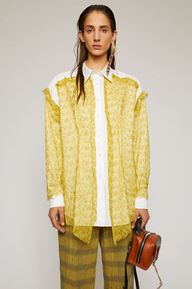 Acne Studios amber yellow shirt is crafted from cotton-poplin with a point collar and a centre button-down closure. It's overlayed with a raw-edged crinkled chiffon that's patterned with a floral motif.