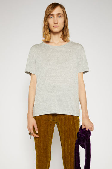 Acne Studios pale grey melange t-shirt is made from lightweight modal and is shaped to drape loosely over the frame and has a round neckline and wide, short sleeves.