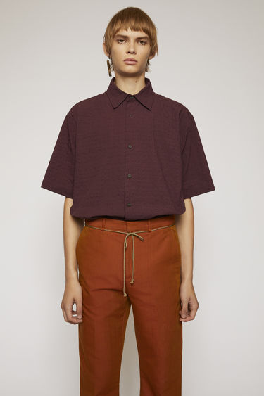 Acne Studios wine red short-sleeved shirt is made from lightweight seersucker and finished with a point collar and button-down front.