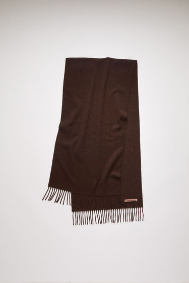 Acne Studios brown melange narrow fringed scarf is crafted from pure wool and finished with a label across one corner.