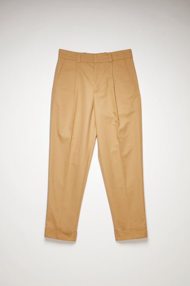 Acne Studios hazel beige trousers are made from lightweight cotton twill and cut to a cropped, tapered leg and neatly finished with front pleats and cuffed hems.
