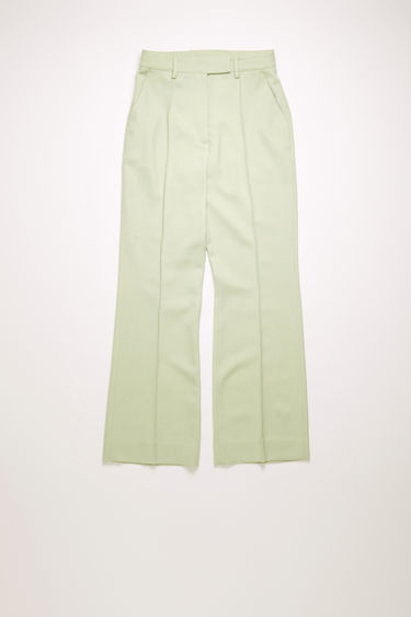 Acne Studios pastel green wool-blend trousers are cut slim through the hips and fall into cropped, kick-flare legs with stitched pressed creases through the front.