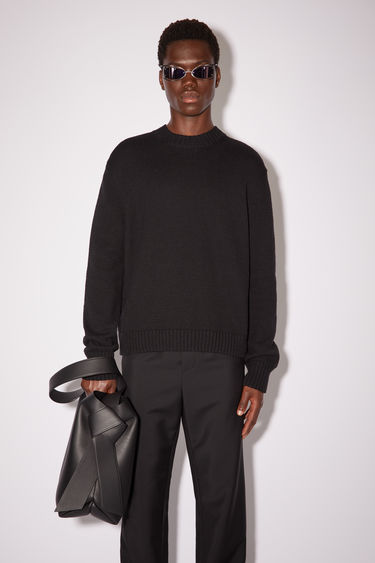 Acne Studios black crew neck sweater is made of pure, shiny cotton with ribbed accents.