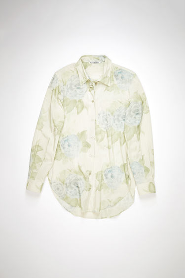 Acne Studios pale blue long sleeve shirt is made of a striped cotton blend, featuring a subtle large scale floral print.