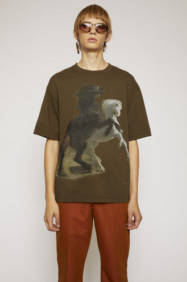 Acne Studios hunter green t-shirt is crafted to a boxy silhouette from textured cotton jersey and features a print of galloping horses.