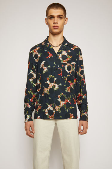 Acne Studios navy blue shirt is crafted from fluid viscose that's patterned with polka dots layered with floral motifs. It's cut for a relaxed fit and has an open collar and a chest patch pocket.